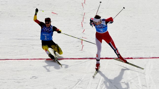 461573887 Silver medalist Germany's Fabian Riessle (L) and Gold medalist Norway's Joergen Graabak cross the finish line in the Nordic Combined Team LH / 4x5 km Cross-Country at the RusSki Gorki Jumping Center during the Sochi Winter Olympics on February 20, 2014, in Rosa Khutor near Sochi.   AFP PHOTO / JOHN MACDOUGALL