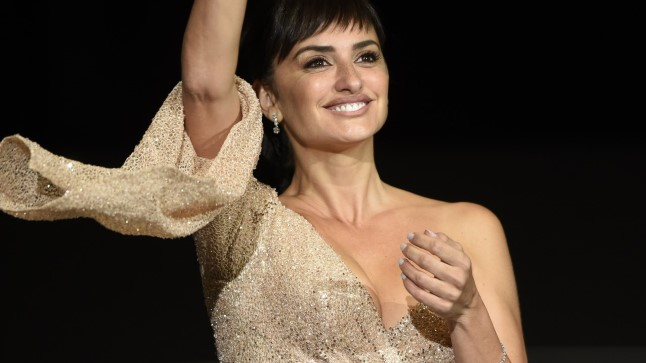 "Spanish actress Penelope Cruz waves as she arrives to attend the screening of the film ""Loving Pablo"" during the 65th San Sebastian Film Festival, in the northern Spanish Basque city of San Sebastian on September 28, 2017. / AFP PHOTO / ANDER GILLENEA"