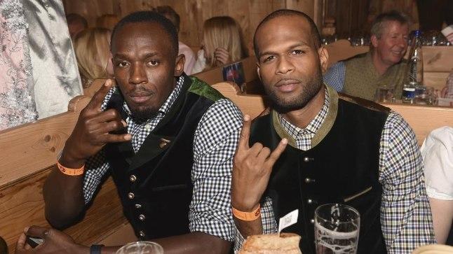 Usain Bolt (vasakul) ja Germaine Mason.