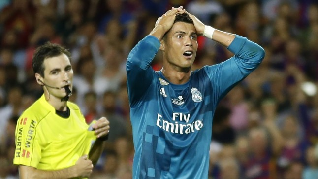 Cristiano Ronaldo, Ricardo de Burgos Real Madrid's Cristiano Ronaldo, right, reacts after Referee Ricardo de Burgos shows a second yellow card during the Spanish Supercup, first leg, soccer match between FC Barcelona and Real Madrid at the Camp Nou stadium in Barcelona, Spain, Sunday, Aug. 13, 2017. Cristiano Ronaldo was banned for five games on Monday after shoving a referee following his red card for diving in Real Madrid's 3-1 win over Barcelona in the season-opening Spanish Super Cup. (AP Photo/Manu Fernandez)