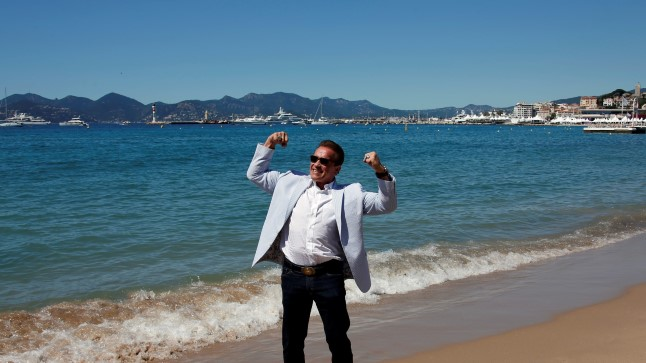 """70th Cannes Film Festival - Photocall for the documentary Wonders of the Sea 3D 70th Cannes Film Festival -  Photocall for the documentary """"Wonders of the Sea 3D"""" - Cannes, France. 20/05/2017.  Actor Arnold Schwarzenegger poses on the beach.  REUTERS/Jean-Paul Pelissier     TPX IMAGES OF THE DAY"""