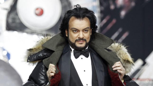 Russian singer Philipp Kirkorov displays a creations by Russian designer Shiyan during Fashion Week in Moscow, Russia, Friday, April 6, 2012. (AP Photo/Misha Japaridze) / SCANPIX Code: 436