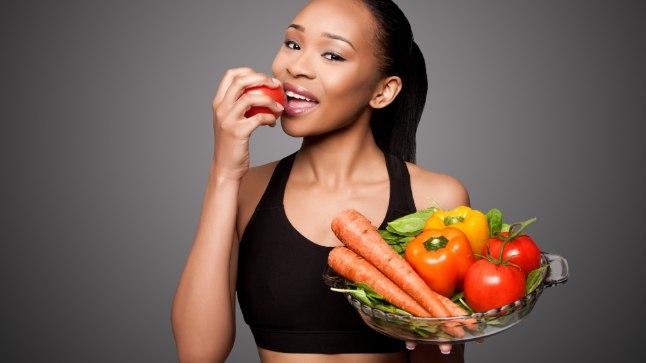 PantherMedia 20885713 Happy healthy black asian woman eating vegetables