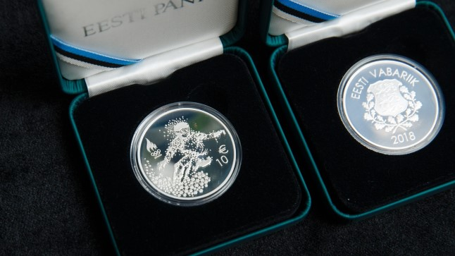 Pyeongchangi olümpiamängude meenemünt ja postmark.