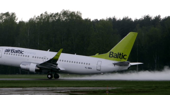 An airBaltic Boeing 737-36Q plane takes off from Riga airport An airBaltic Boeing 737-36Q plane takes off from Riga airport May 13, 2010. The Latvian national airline airBaltic carried 835,700 passengers in the first four months of this year, which is a growth by 16 percent from the same period in 2009, the airline reported. REUTERS/Ints Kalnins (LATVIA - Tags: TRANSPORT BUSINESS)