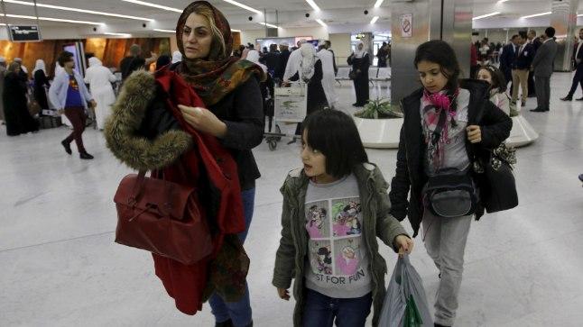 Soomest Iraaki lahkunud sisserändajad Bagdadi lennujaamas.