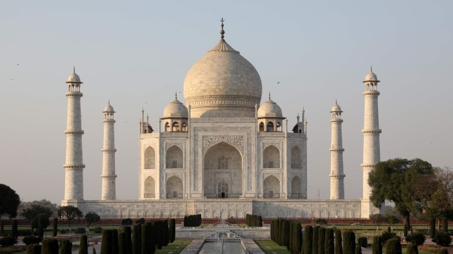 "(FILES) In this file photo taken on March 11, 2018 The Taj Mahal mausoleum is pictured in the Indian city of Agra. Cultural activists on April 29 accused the Indian government of privatising historic relics such as the Taj Mahal after it launched a controversial scheme allowing companies to ""adopt"" dozens of monuments.     / AFP PHOTO / Ludovic MARIN"