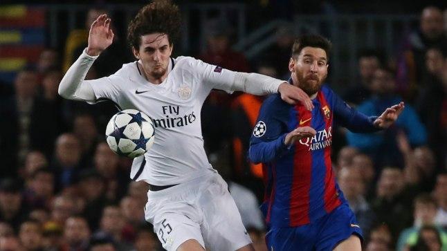 Adrien Rabiot võitlemas Lionel Messiga.