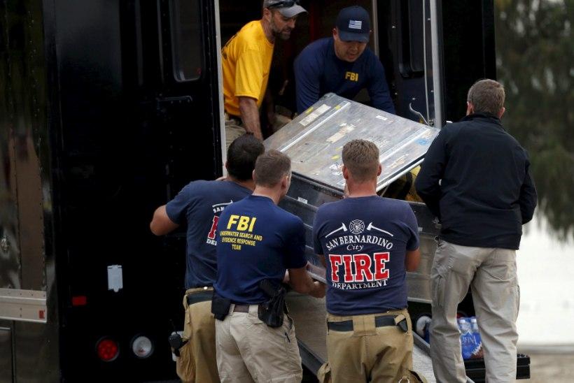 GALERII | FBI agendid ja sukeldujad otsivad järvest terrorijälgi