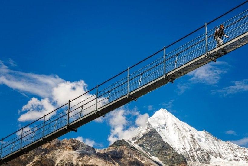 GALERII | Pool kilomeetrit 85 meetri kõrgusel: maailma pikim jalakäijate sild