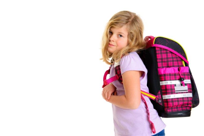 Terviseamet: algklassilaste koolikotid on liiga rasked