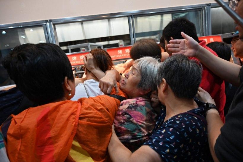 VIDEO   RAHVAMASSID: Hiinas läks hulgipoe avamispäeval korralikuks mäsuks